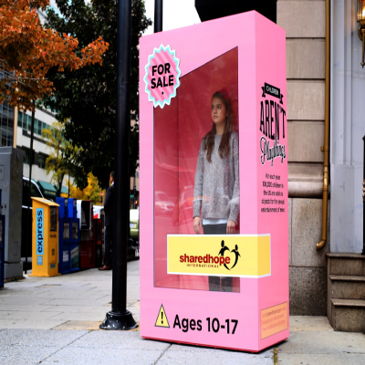 "7 foot tall dollbox to send ""Children Aren't Playthings"" message"